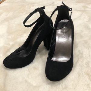 Black pumps with ankle straps